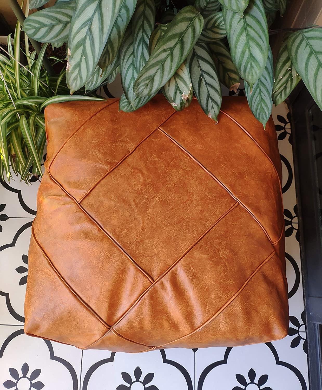 Square faux leather pouf