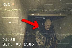 a terrifying clown walking up some basement stairs