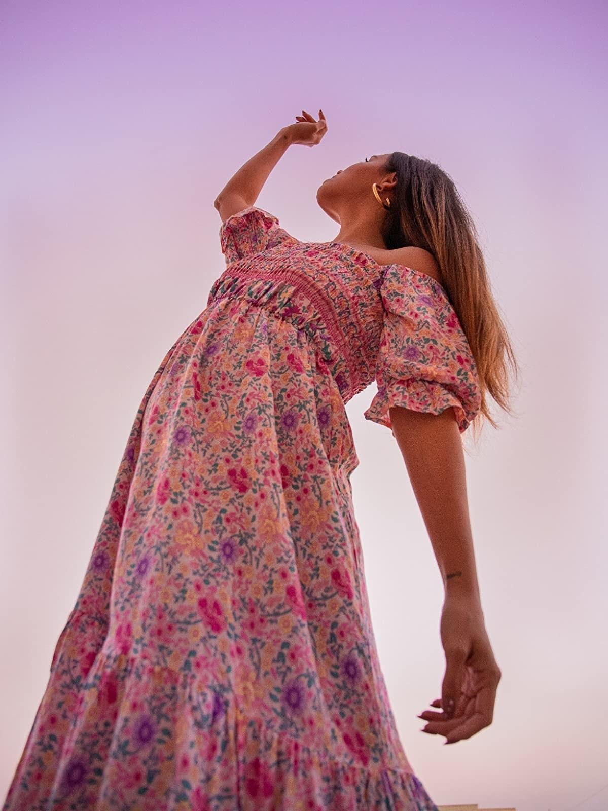 A reviewer wears the dress