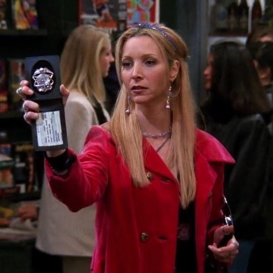 Phoebe holding up a bad and saying freeze