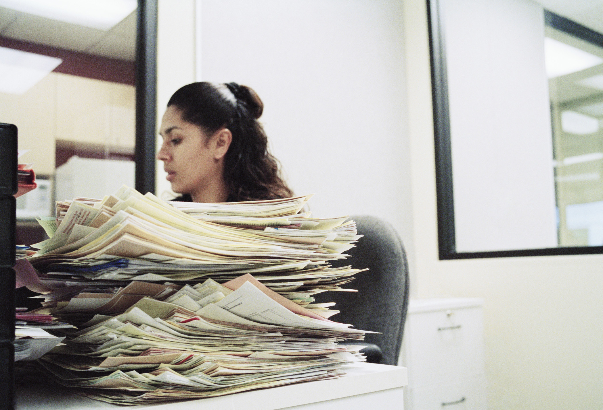 Woman with a pile of paperwork