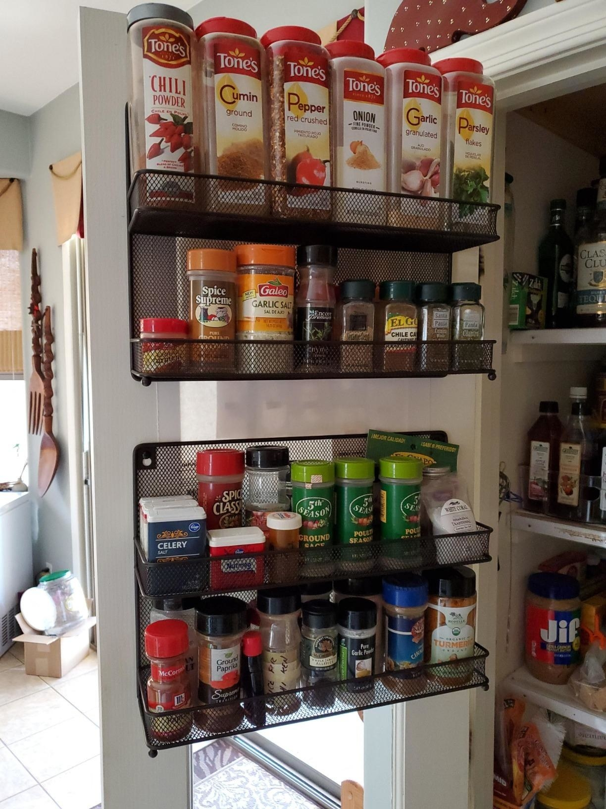 The racks, installed on a pantry door, and filled with spices