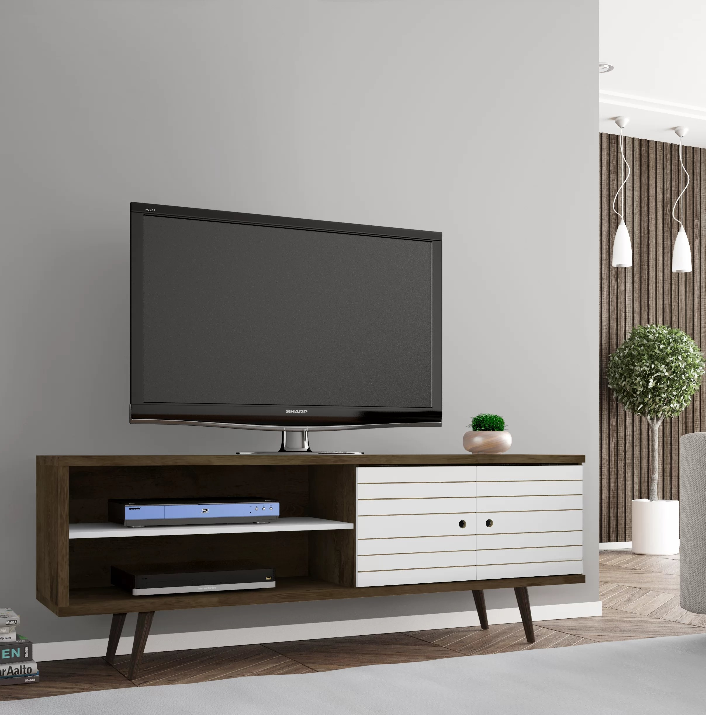 The wood TV stand with flared legs supporting a TV in a living room