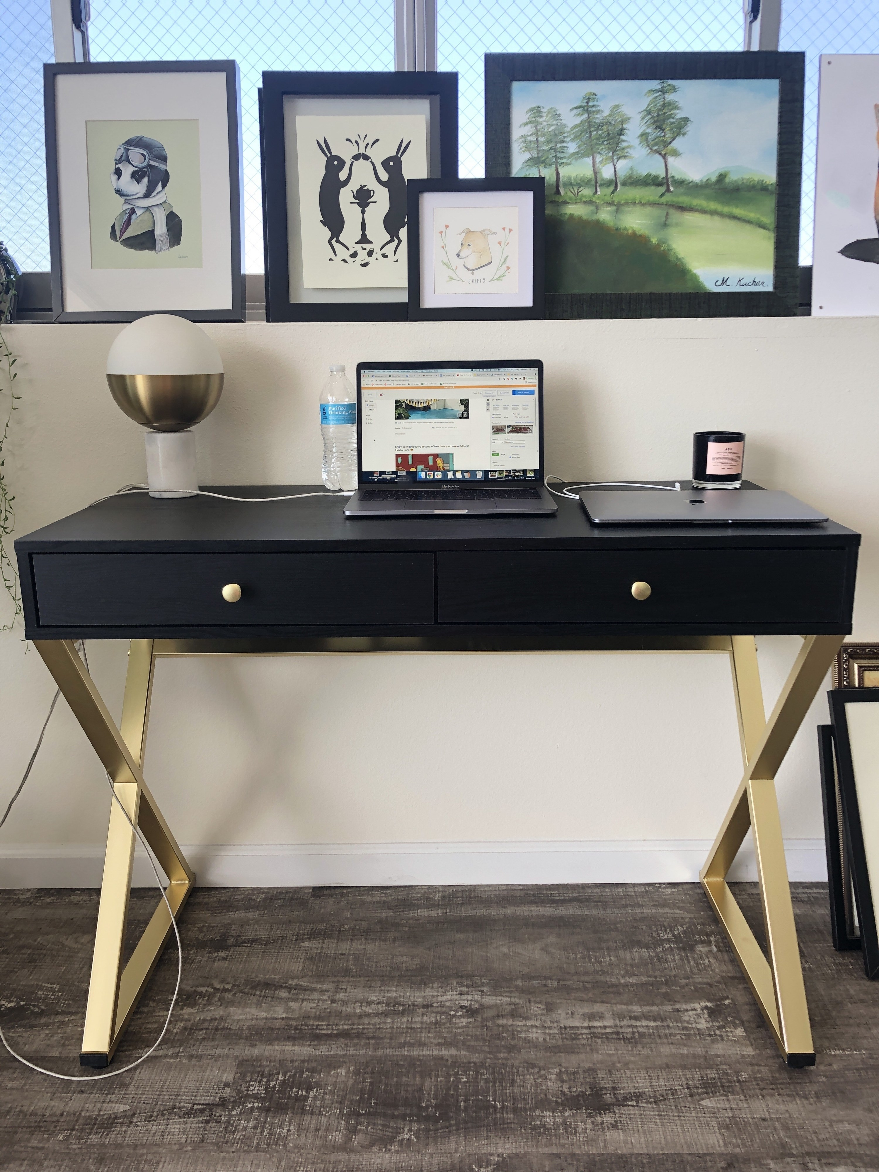 The desk is displayed against a wall