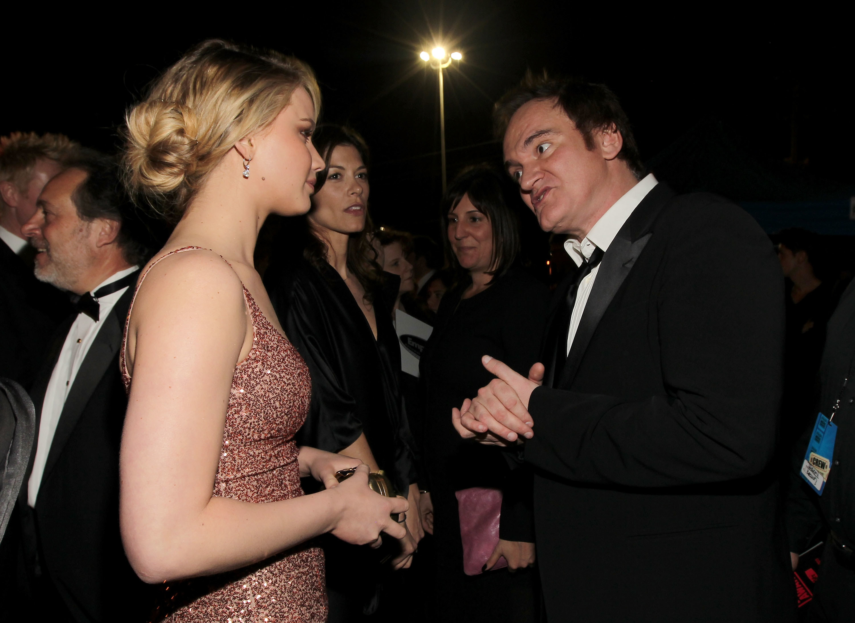 Jennifer and Quentin talk at an event