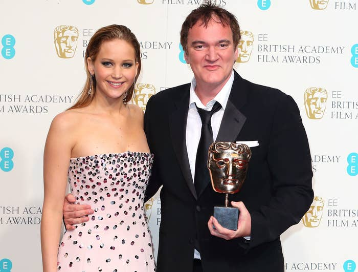 Jennifer poses with Quentin while he holds up an award