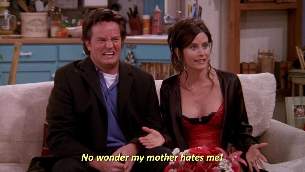 Chandler and Monica looking confused at Phoebe