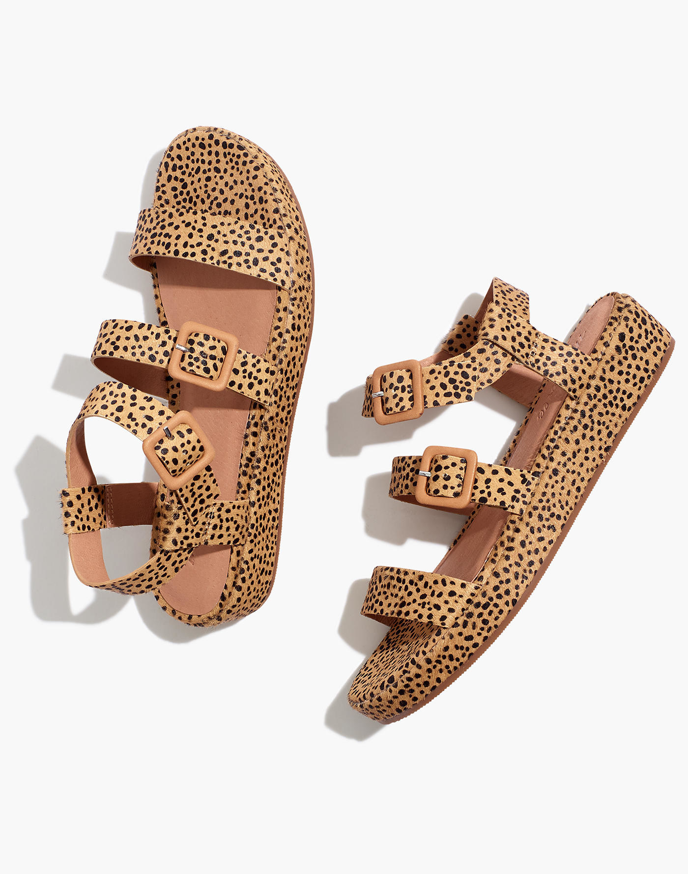 platform sandals with buckles and horizontal straps and a spotted calf hair design