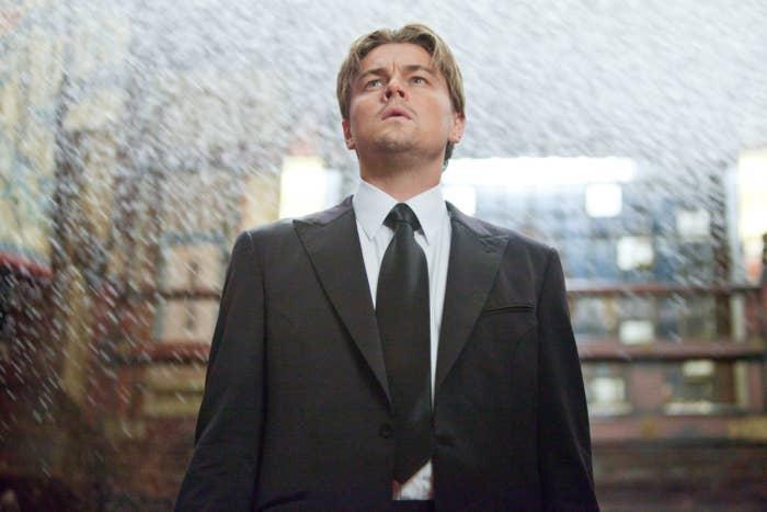 Leonardo DiCaprio in a suit looking up