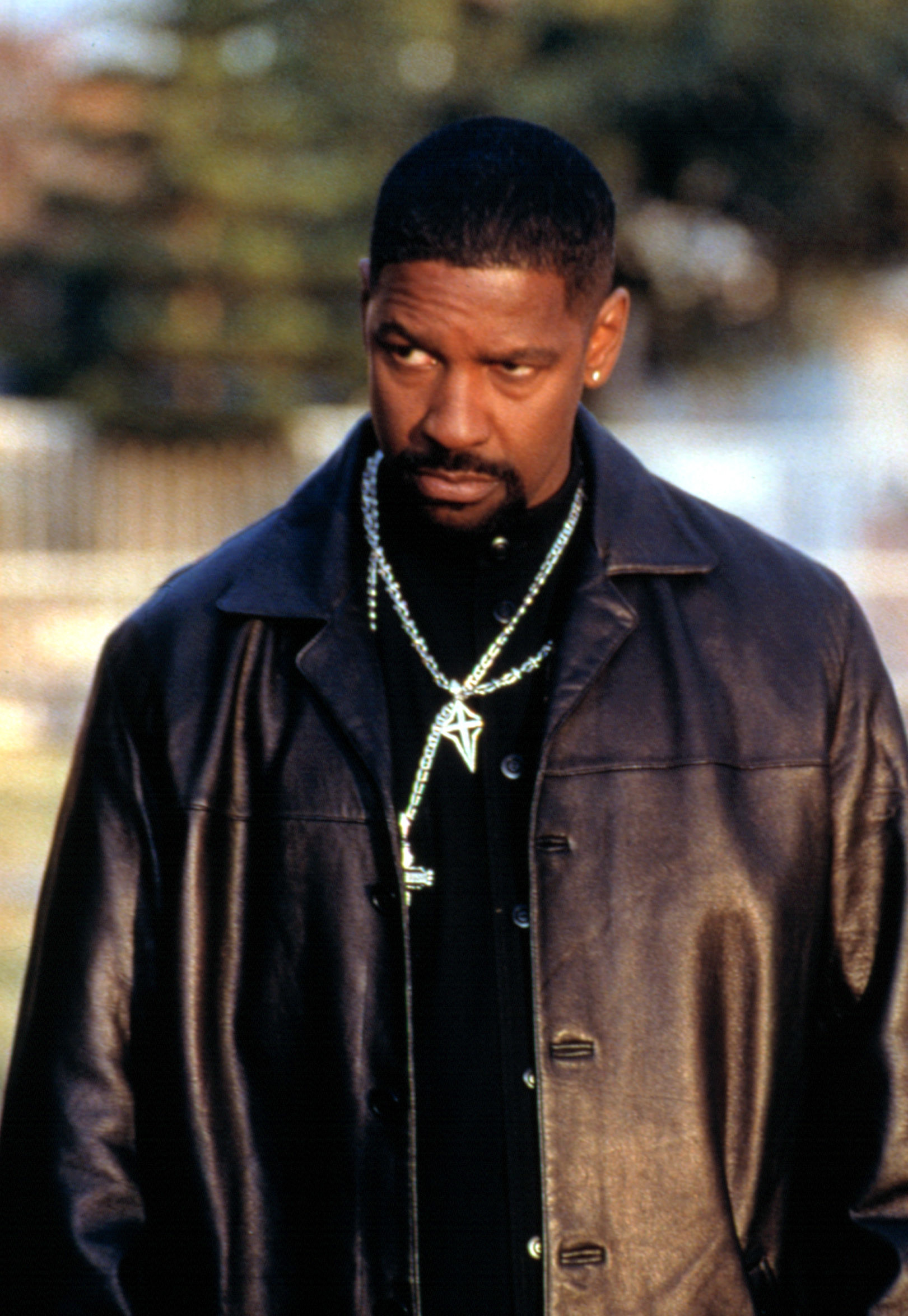 Denzel in a leather jacket