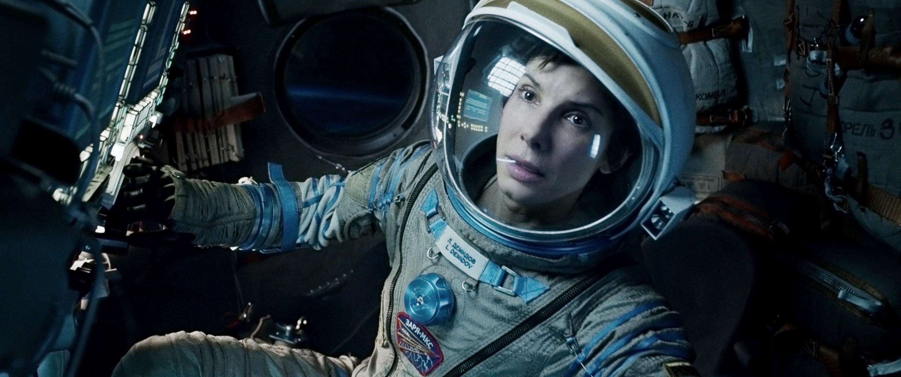 Sandra Bullock as an astronaut in space