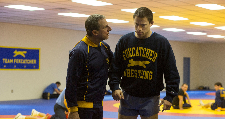 Steve Carrell coaching Channing Tatum in a wrestling gym