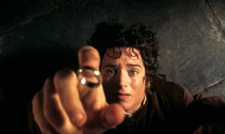 Frodo on the inn floor as the ring falls onto his finger