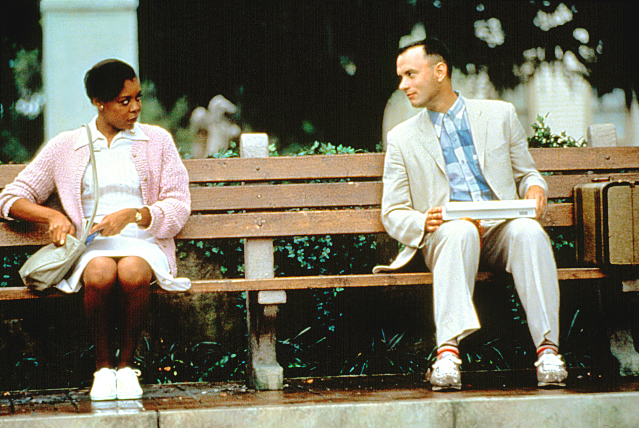 Forrest talking to a woman on the bench
