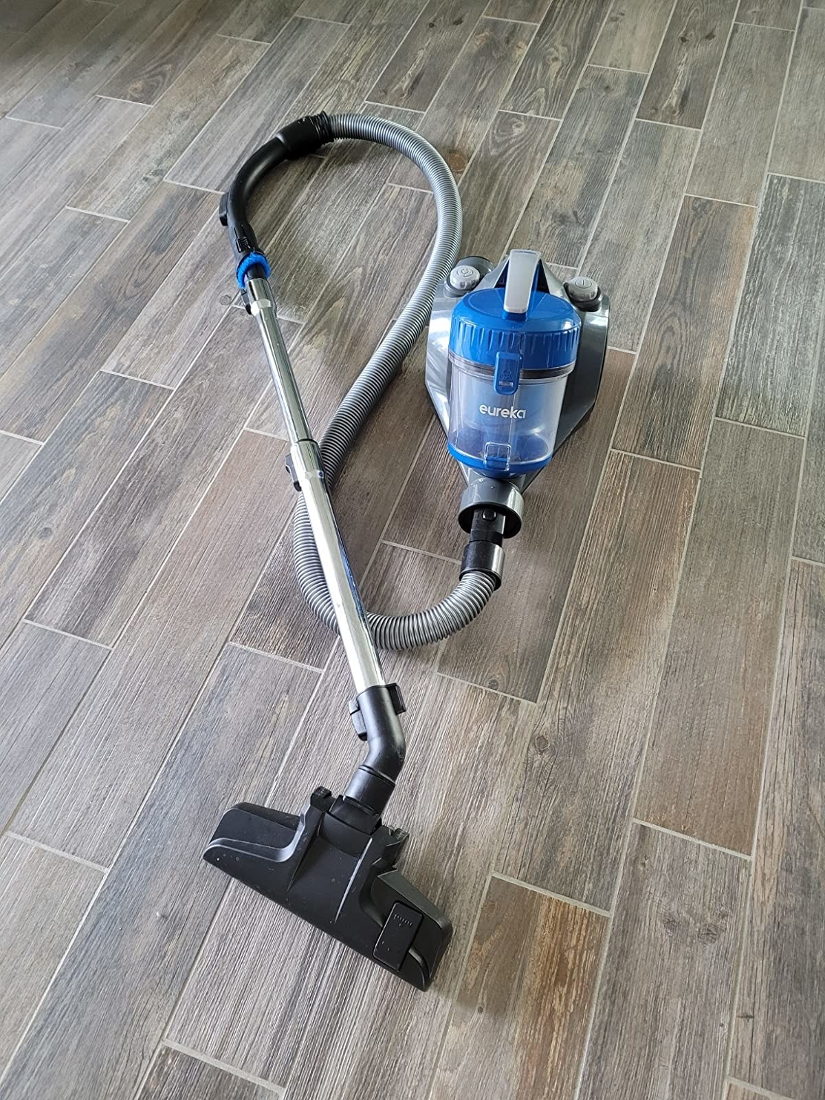 Blue and gray vacuum with metal and black accents