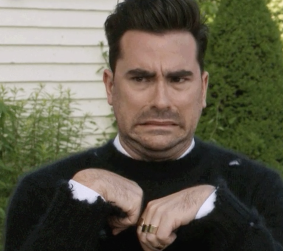 Annoyed and grossed out Dan Levy as David Rose