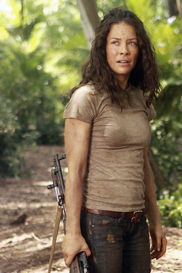 Kate carrying a gun
