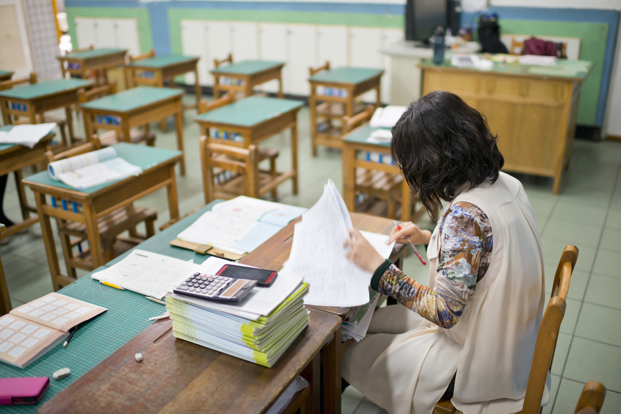 Woman grading papers