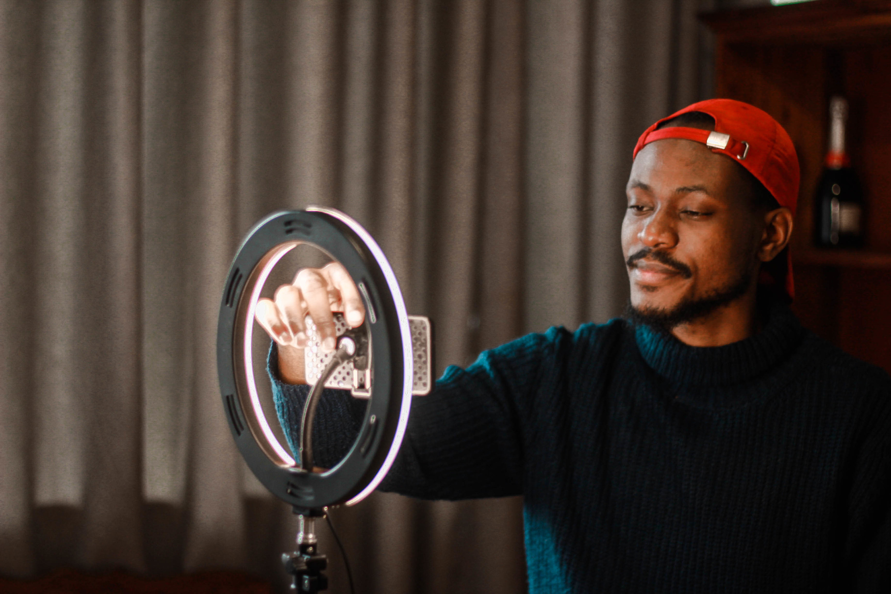 YouTuber setting up his camera inside his ring light.