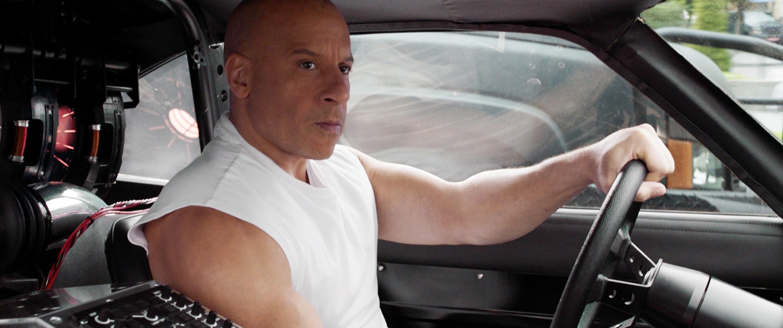 Vin Diesel driving a car in F9