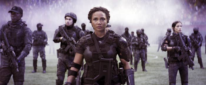 Jasmine Mathews preparing for battle with soldiers behind her