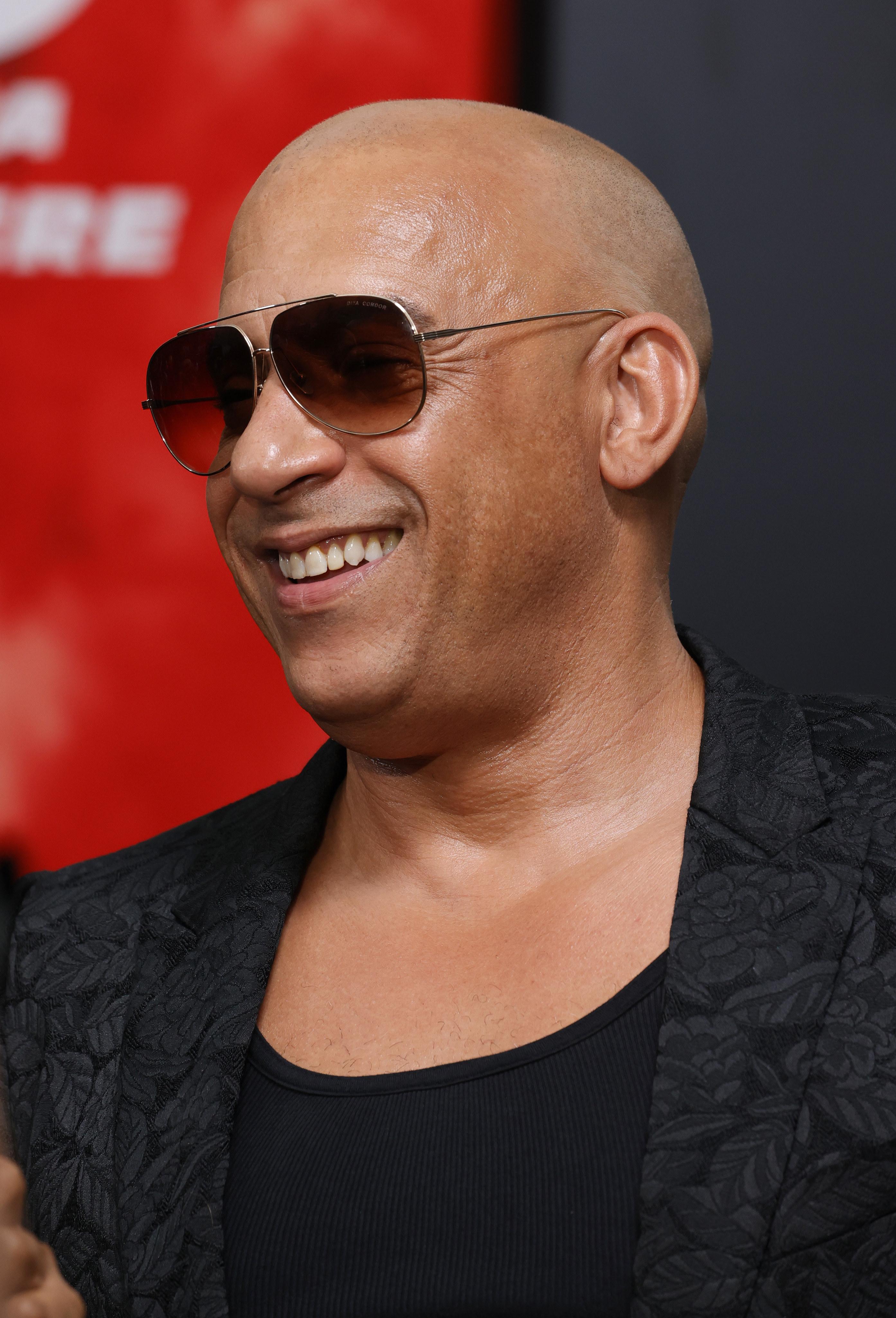 Vin Diesel on the red carpet wearing sunglasses