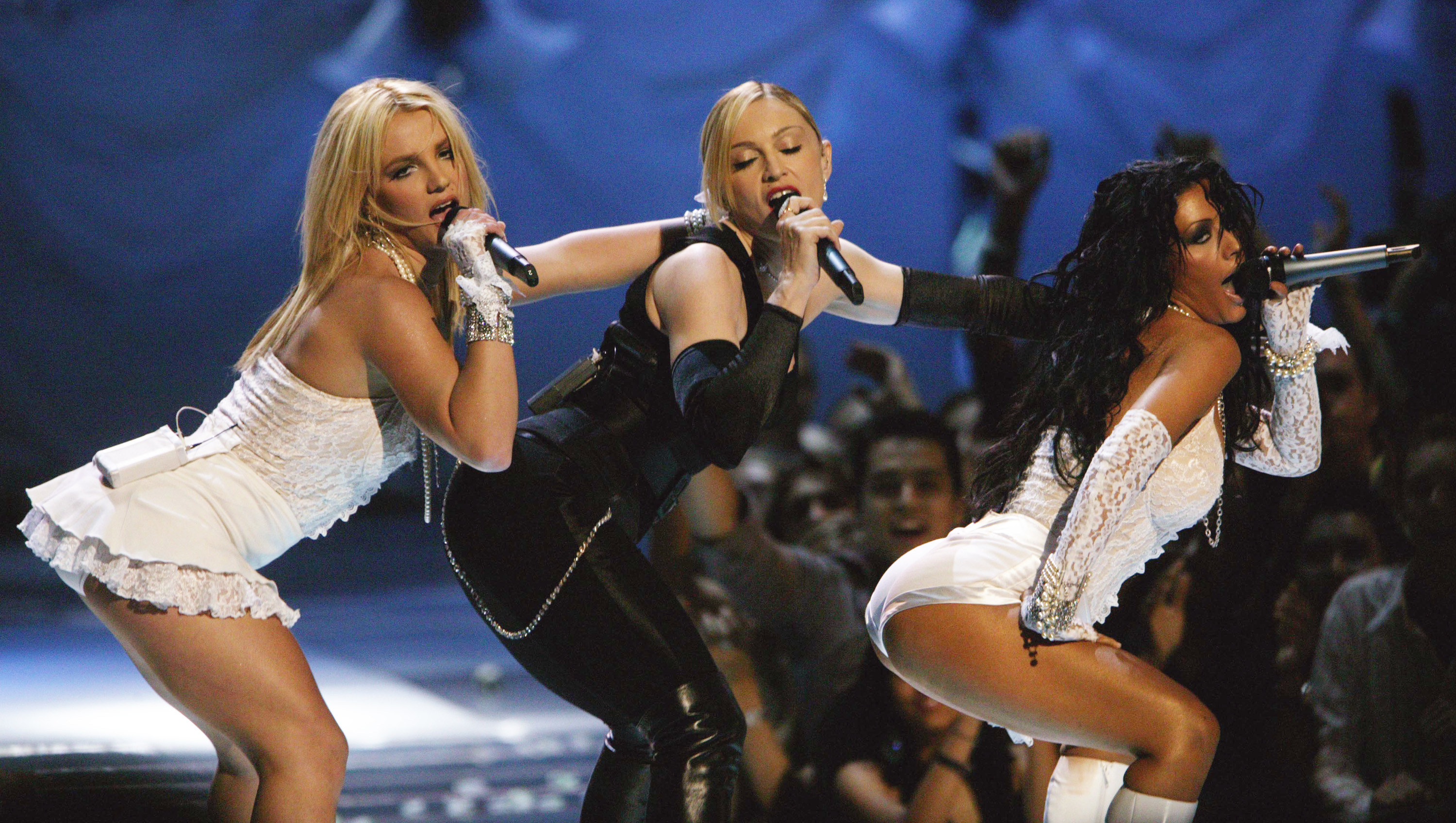 Britney Spears, Madonna, and Christina Aguilera perform next to each other onstage at the 2003 MTV Video Music Awards