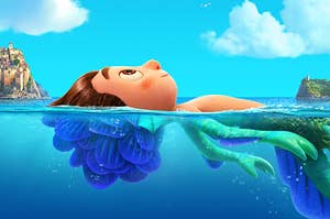 Luca float on the water's surface, the submerged part of him revealing that he's a sea monster