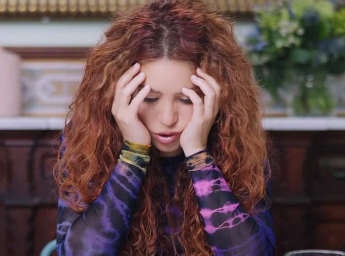 Shakira puts her head in her hands during the interview