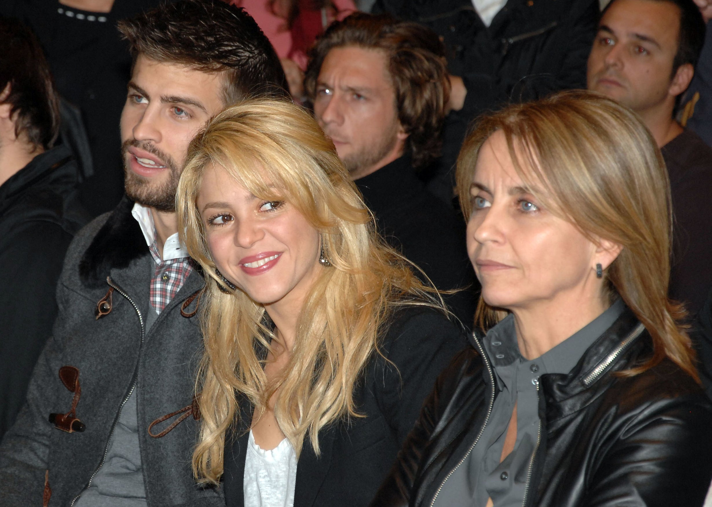 Shakira smiles while sitting next to her mother-in-law at an event
