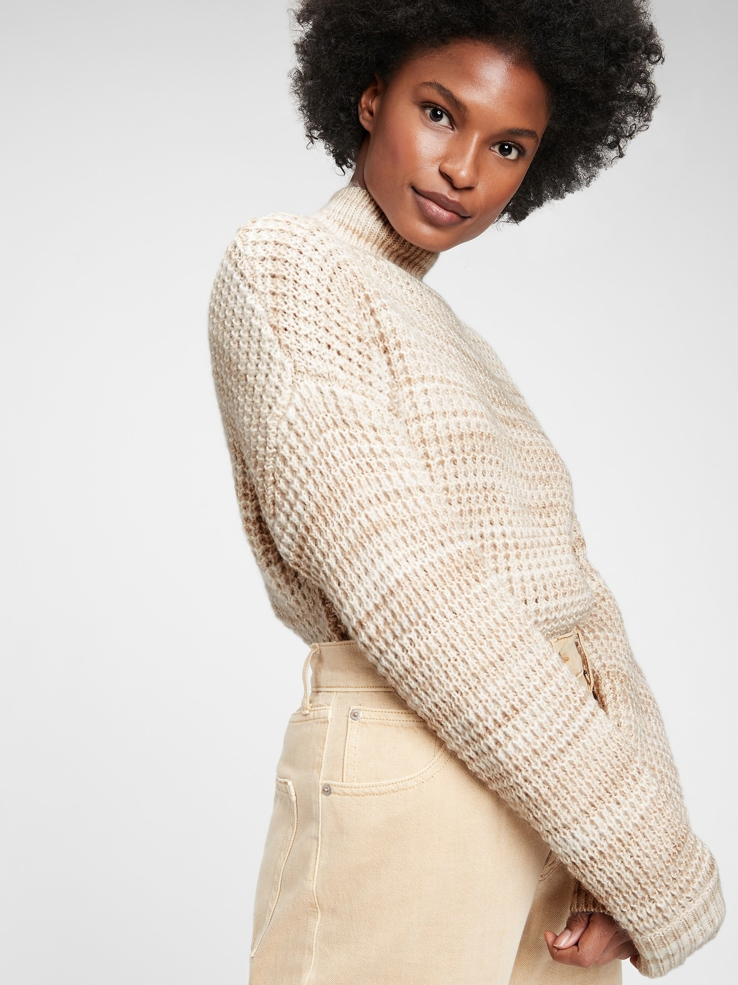 The sweater in natural beige