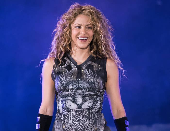 Shakira smiles on stage during a performance
