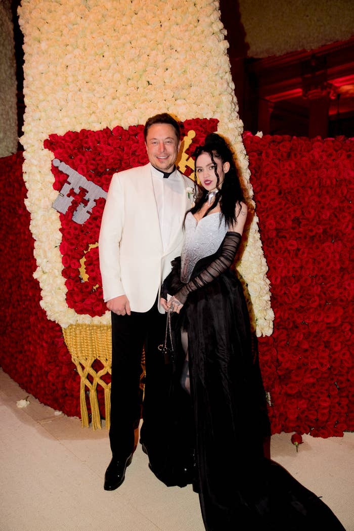 Wearing a tuxedo and a gown, Elon Musk and Grimes attend the Heavenly Bodies: Fashion & The Catholic Imagination Costume Institute Gala at the Metropolitan Museum in May 2018, in New York City