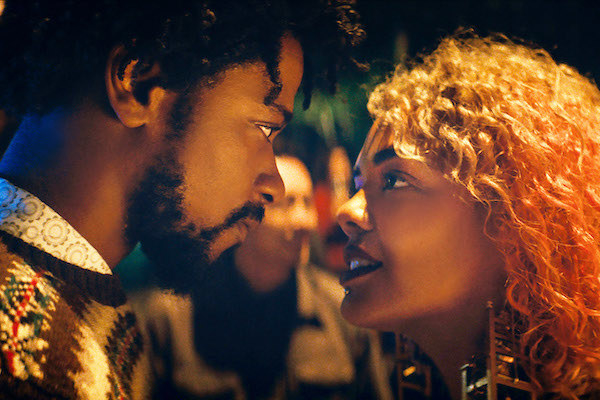 LaKeith Stanfield and Tessa Thompson having an intimate conversation