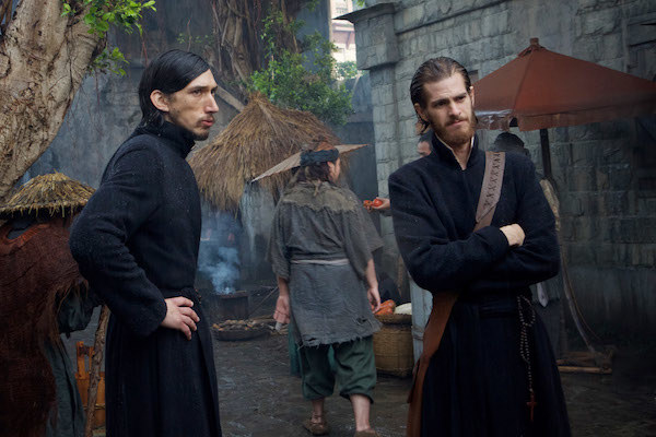 Adam Driver and Andrew Garfield looking concerned while talking