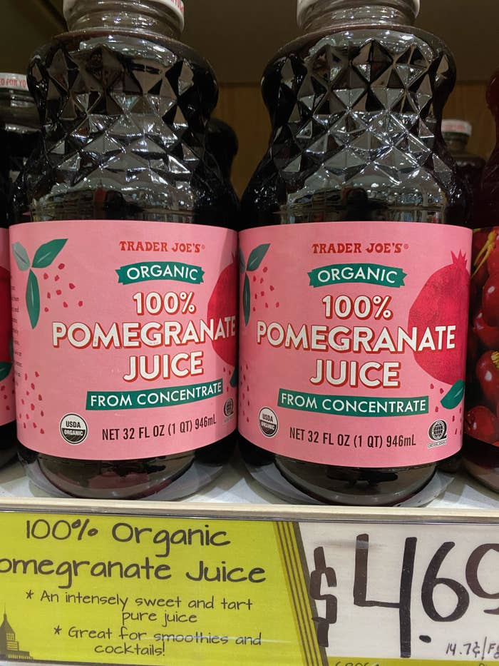 Two bottles of 100% Pomegranate Juice.