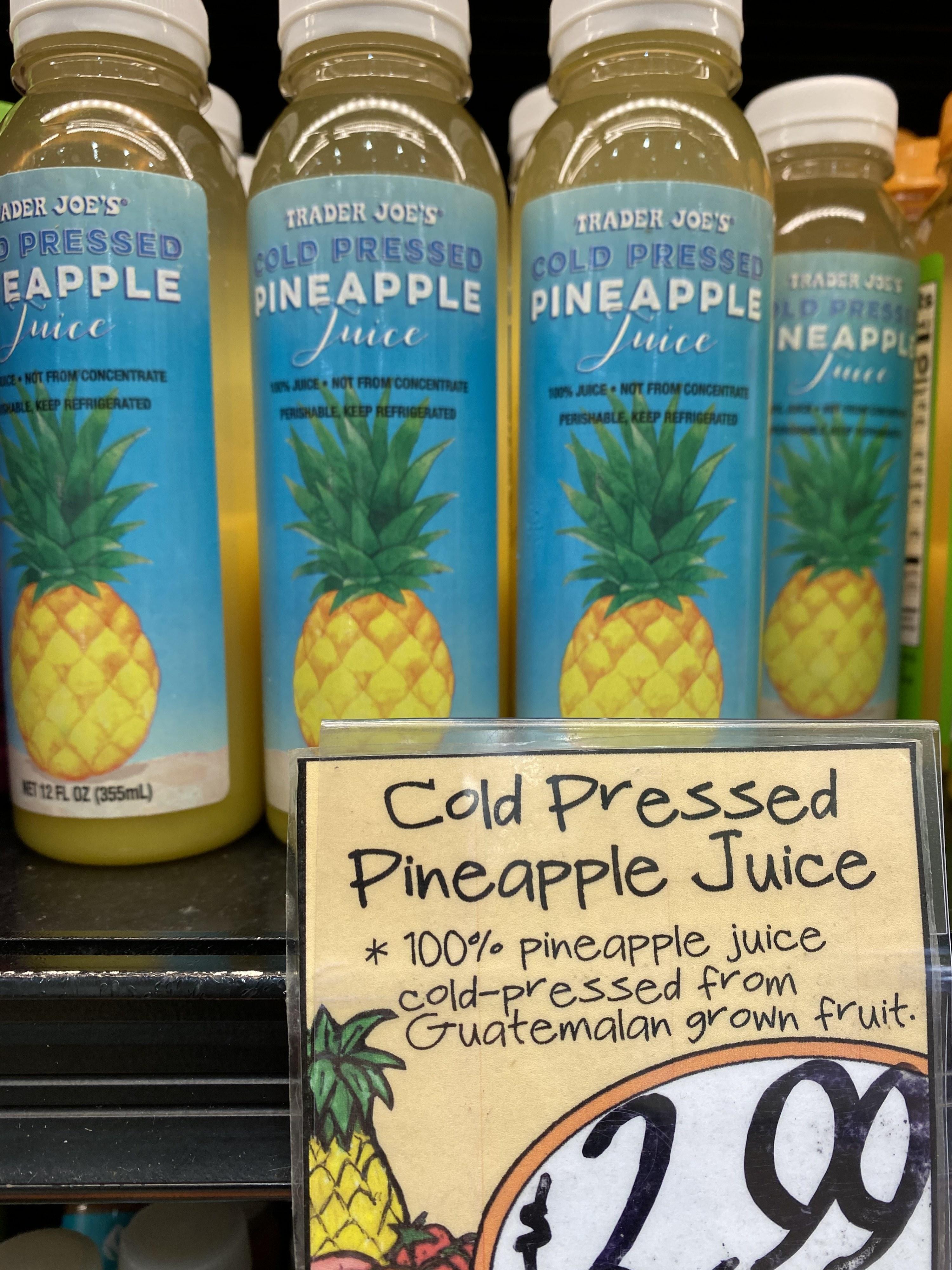 Bottles of Trader Joe's cold pressed pineapple juice.