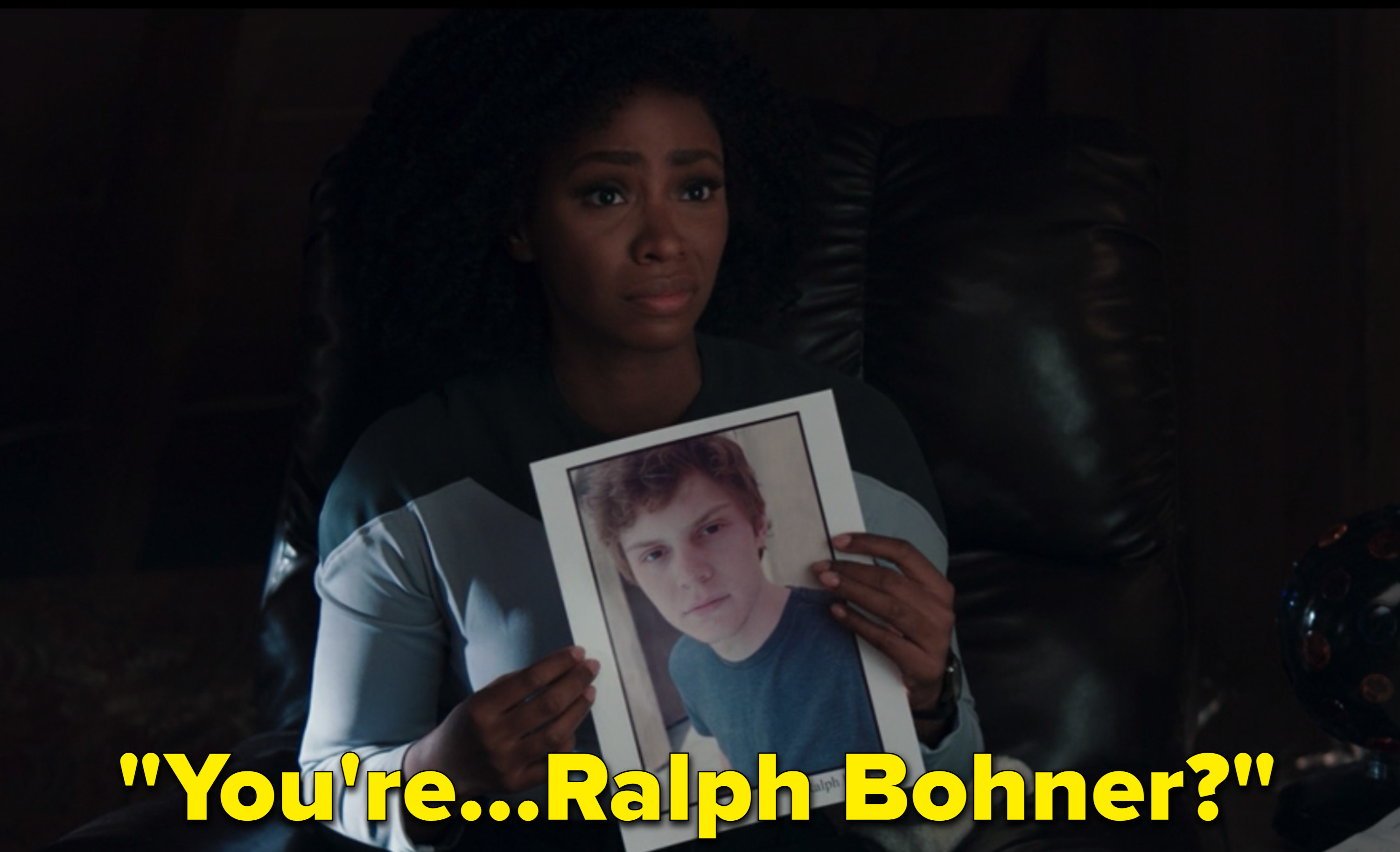 Monica Rambeau holds up a picture of Ralph Bohner, a teenager whose house Agatha took over in Westview.