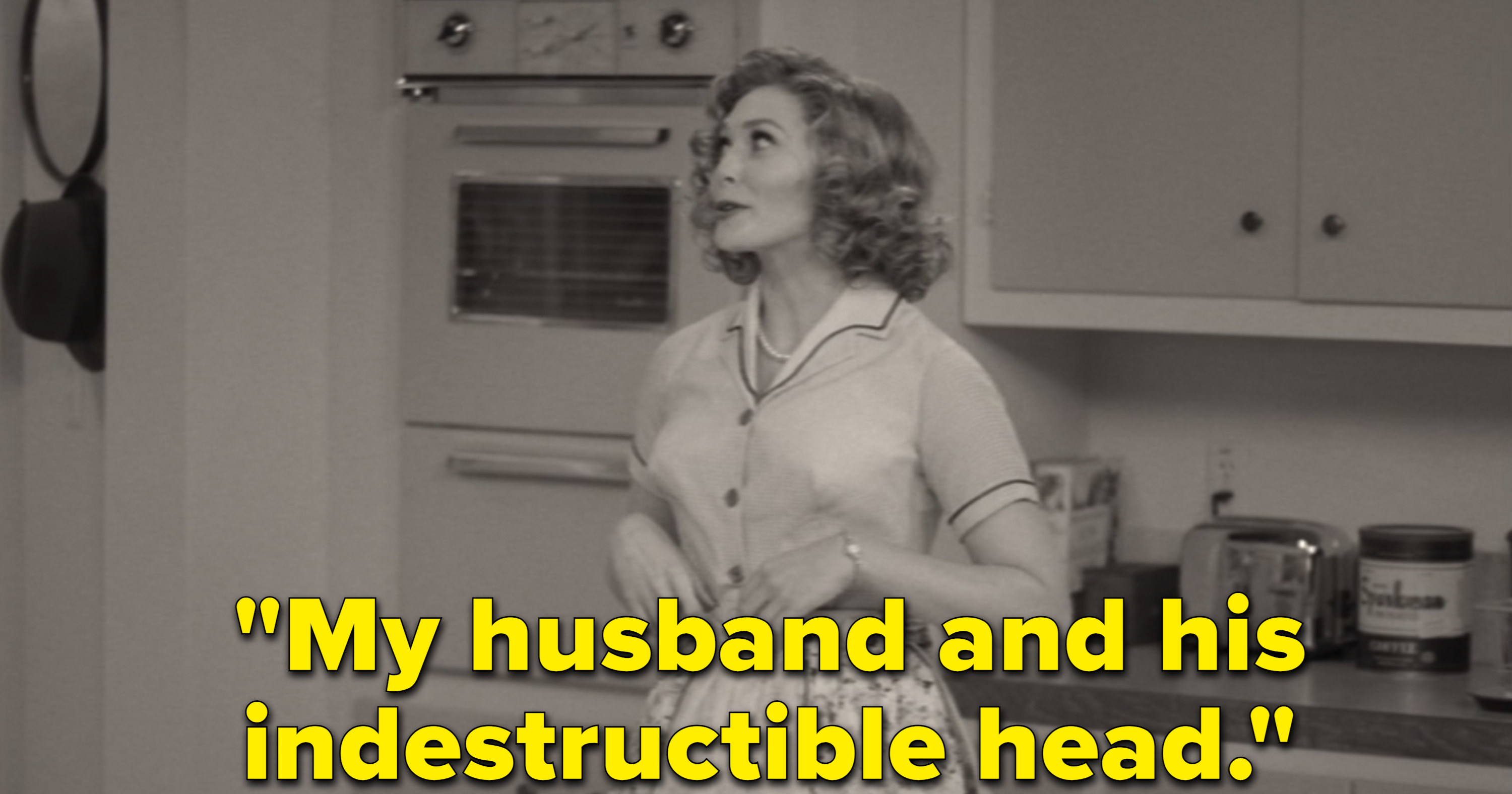 """Wanda, tinted in black and white, tells Vision, """"My husband and his indestructible head."""""""