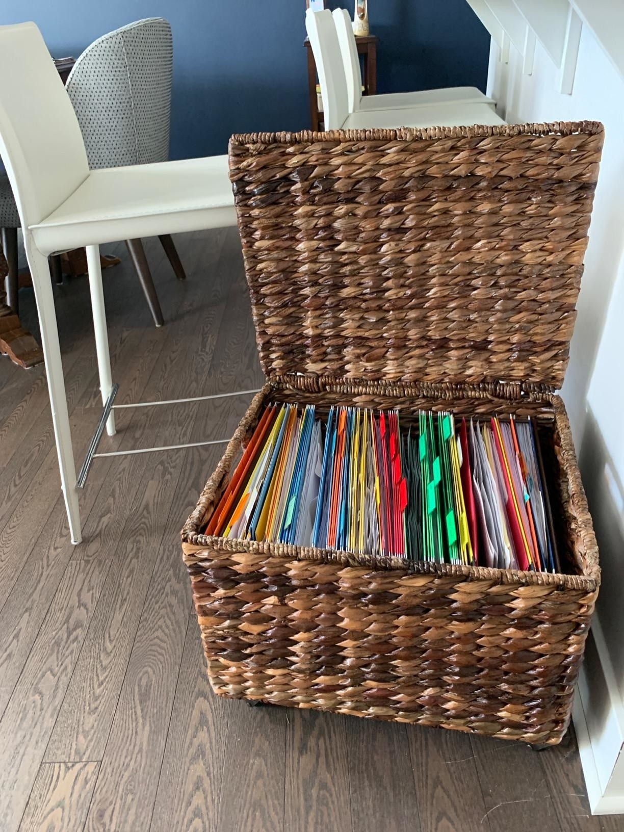 reviewer image of the espresso birdrock seagrass rolling file cabinet open to reveal lots of filing folders