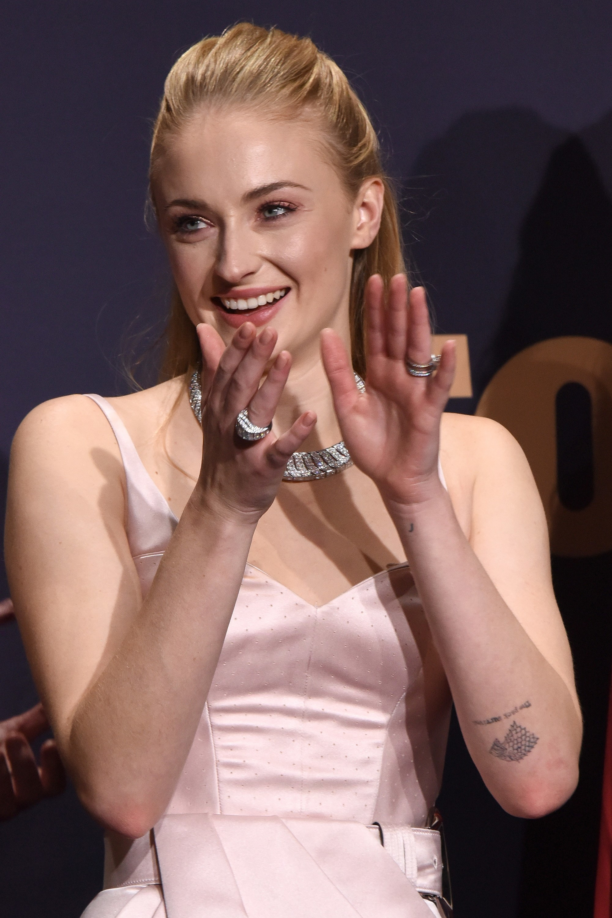 Sophie Turner claps and smiles in the press room for 71st Primetime Emmy Awards