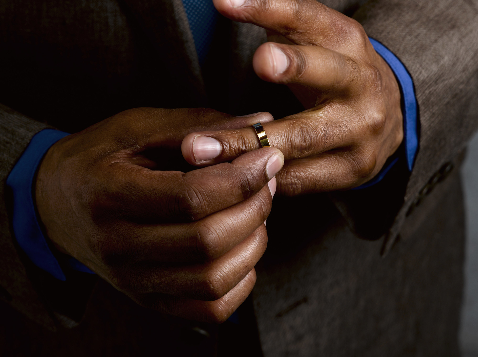 A man's hand with a wedding ring