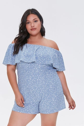 front view of a model in the blue polka-dotted romper