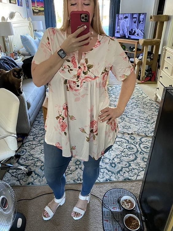 a person wearing a floral blouse