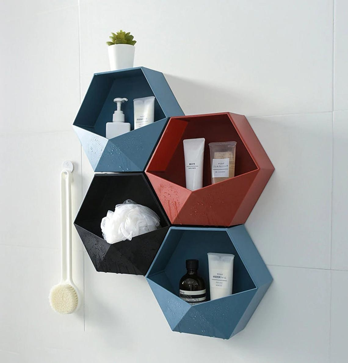 Three of the shelves puzzled together on a shower wall