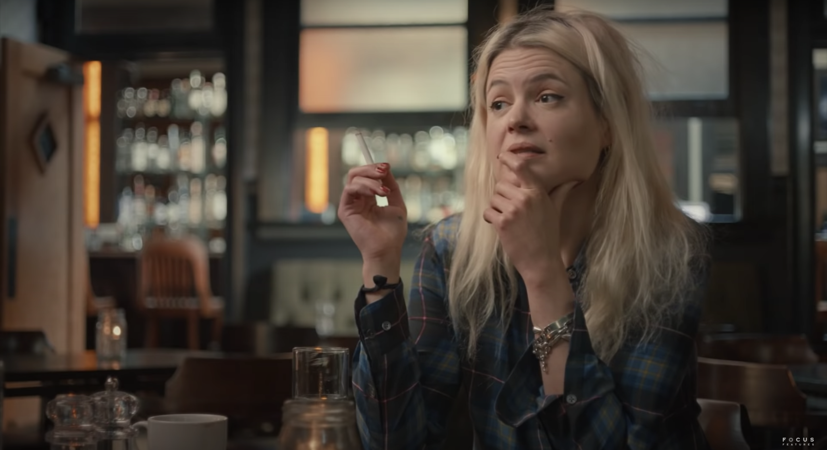 The Kills singer Alison Mosshart sits in a bar, cigarette in hand, pondering her friend Anthony Bourdain