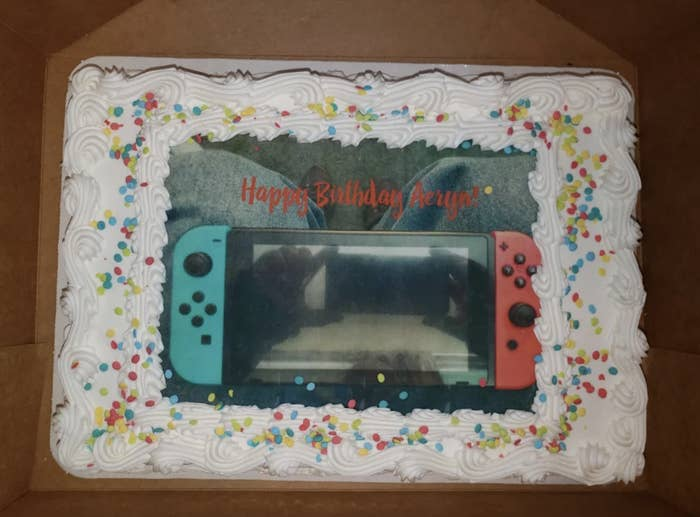 Photo of a Switch placed on a cake when the cake itself was supposed to resemble the Switch