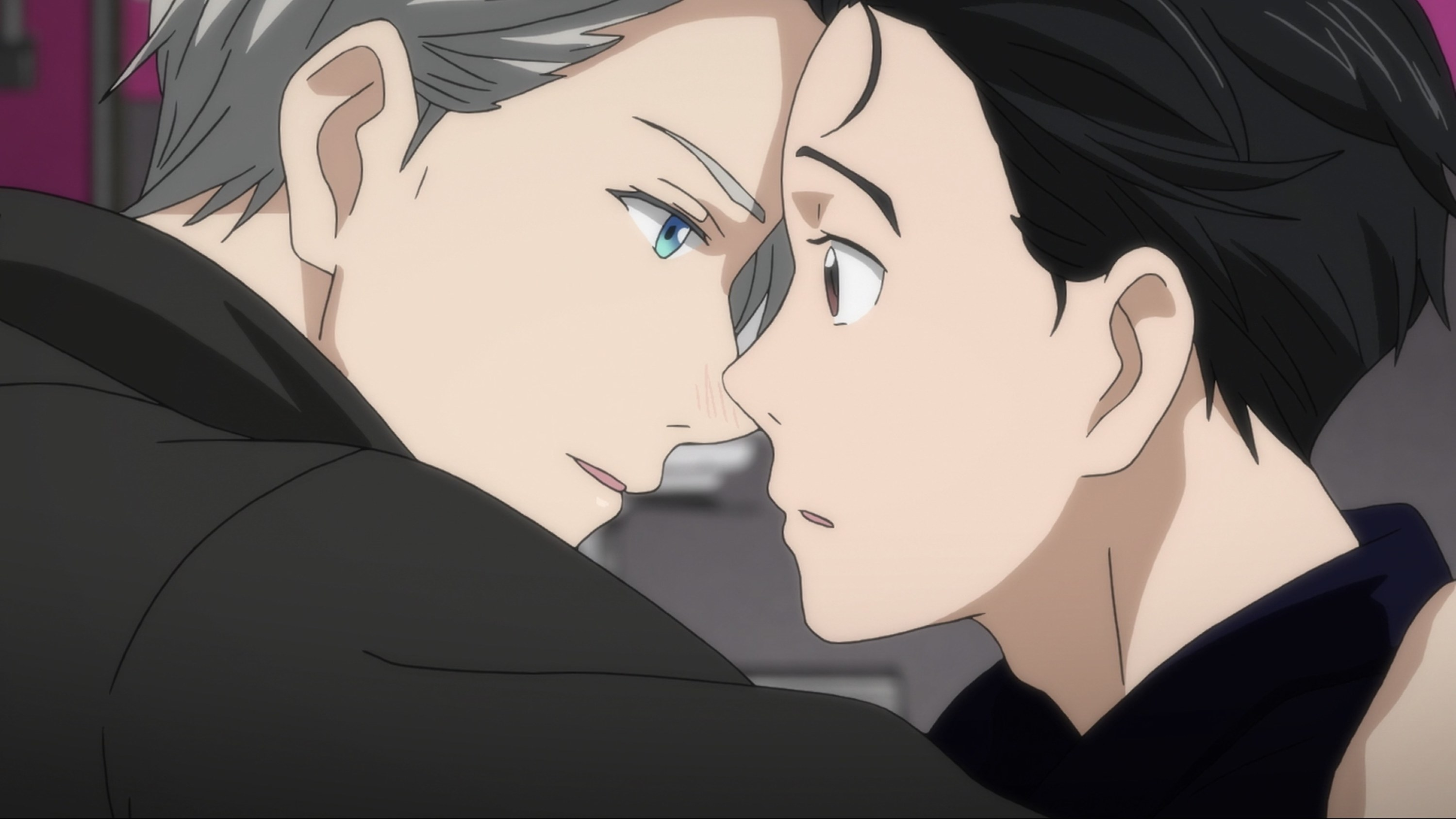 Victor and Yuri looking into each other's eyes almost as if they were about to kiss.
