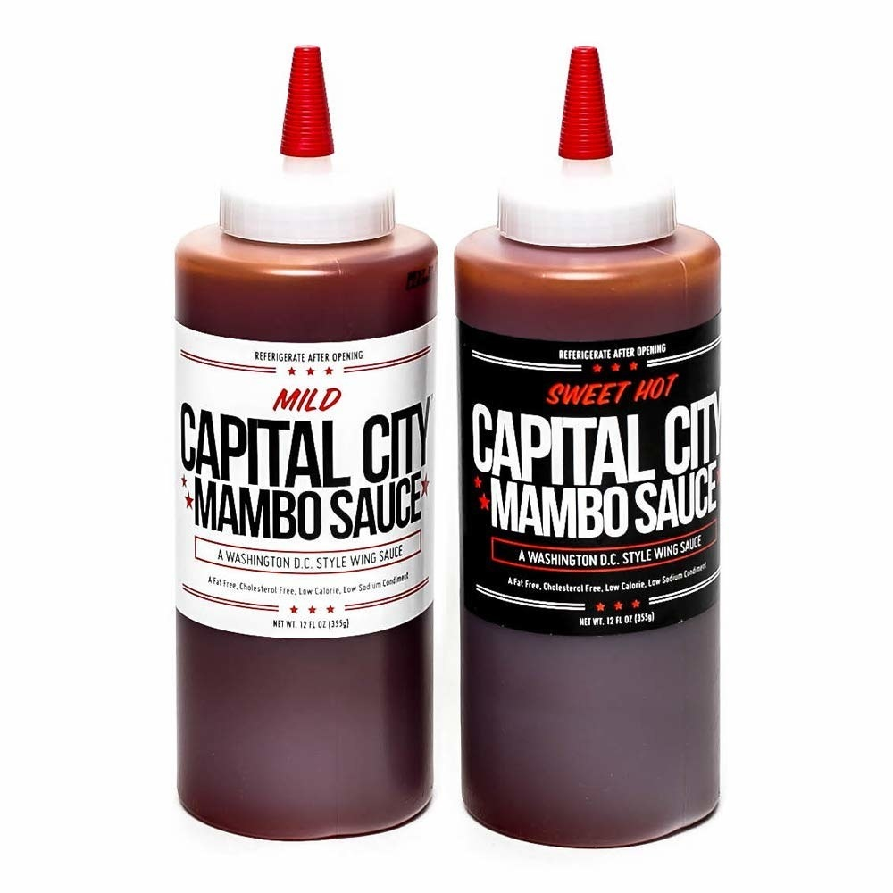 Two bottles of the Capital City Mambo Sauce in Mild and Sweet Hot