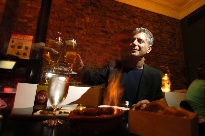 Chef Anthony Bourdain has a drink at Tintol restaurant in New York City's Times Square